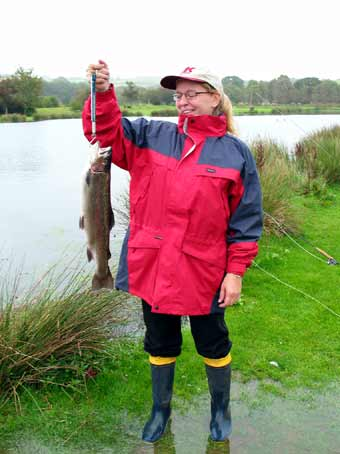 Kay catches a four pounder at Exe Valley