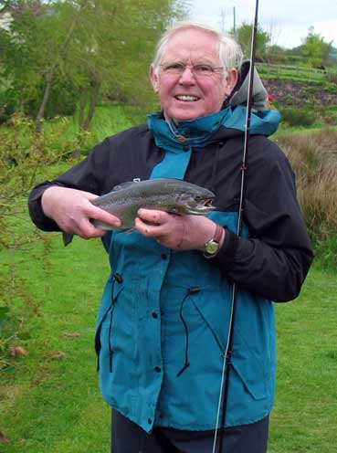 John catches his first fish at Exe Valley