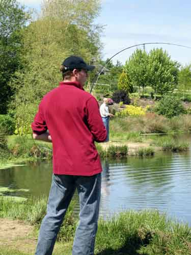 Tim into his first fish at Exe Valley Fishery